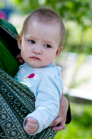 Portrait of little baby girl in the sling Stock Photo - 12394617