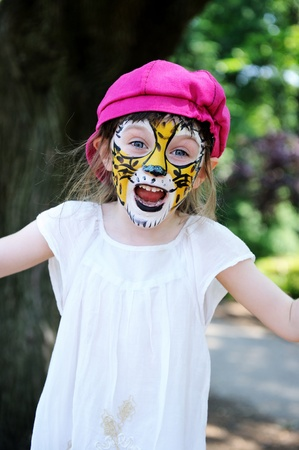 Cute little girl with face painted on a hot summer day Stock Photo - 12842266