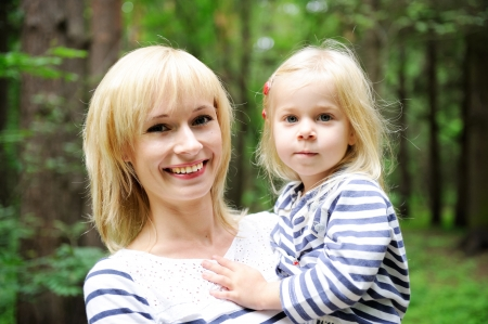 single parents: Outdoor portrait of a young mother posing with her daughter in the park Stock Photo