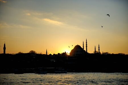 Mosque silhouette at sunset, Istanbul, Turkey photo