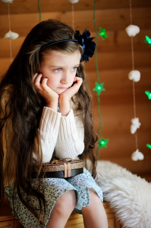 child sad: Sad little girl waiting for magical Christmas night Stock Photo