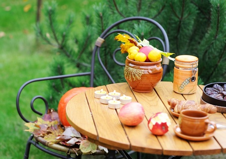 tea candles: Wooden table set outdoors in garden setting Stock Photo