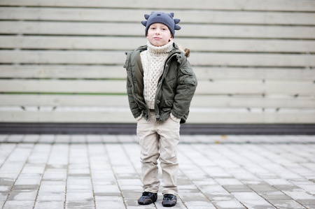 street kid: Outdoor portrait of child boy wearing funny hat Stock Photo