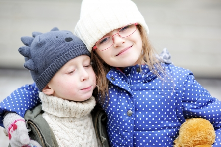 Portrait of little boy and girl posing together outdoors Stock Photo - 17369693