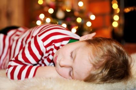 Short-haired toddler boy sleeping on the floor Stock Photo - 17369691