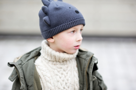 Outdoor portrait of child boy wearing funny hat photo