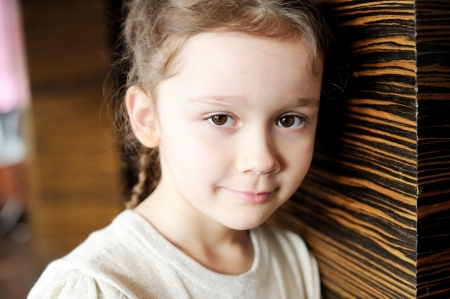 Portrait of cute brunette toddler girl photo