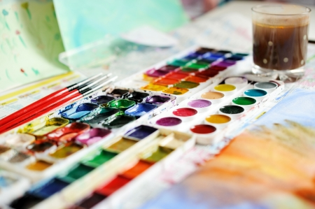 Water color drawing, paints and brushes photo