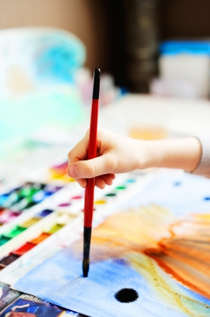 Child drawing with brush photo