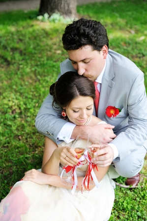 Portrait of bride and groom embracing at a picnic photo