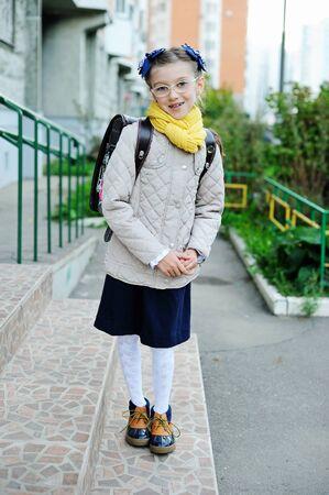 schoolgirl uniform: Beauty kid girl in uniforam and jacket on her way to school Stock Photo