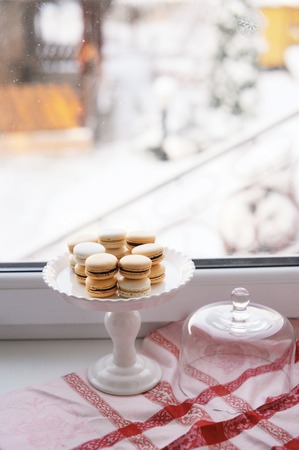 Coffee and sweets on the window with winter view  photo
