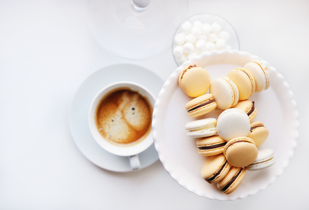 Coffee and sweets on the white table photo
