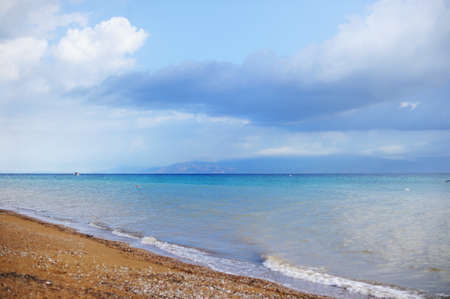 horizon over water: Stormy sky over the sea deserted beach. Bad weather at sea. Off Season Stock Photo