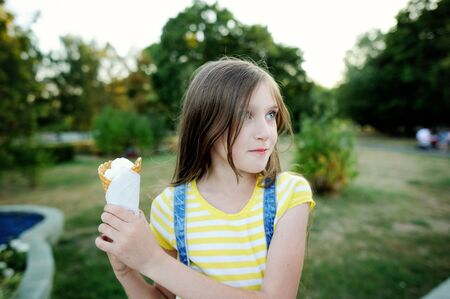 cupidity: Adorable kid girl dont want to share ice cream. Family lifestyle