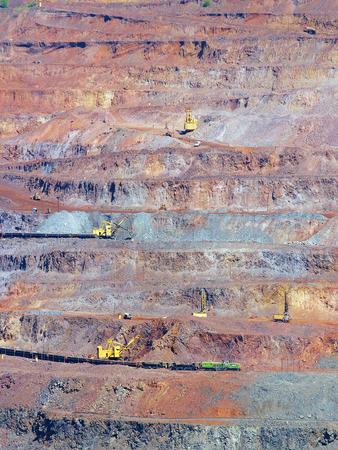 ore: Iron ore extraction in multi-level open-cast mine Stock Photo