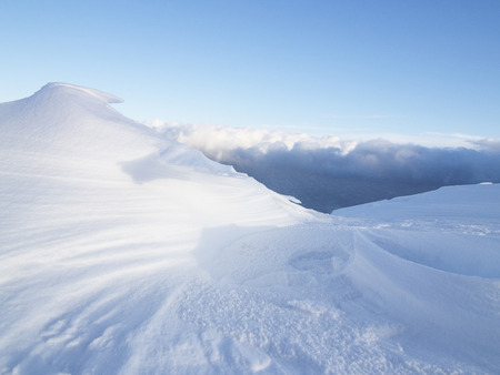 cloud drift: Snowdrift against a blue sky and clouds