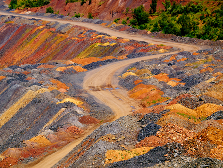 dumps: Road through dumps of depleted iron ore