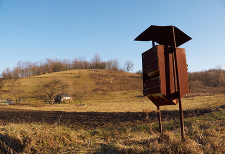 haymow: Old common mailbox in countryside with the hill and trees on the background