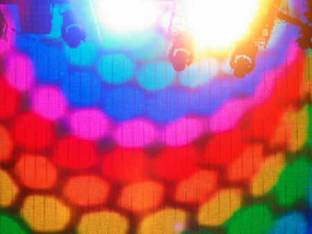 vibrance: Colorful led screen stage with spotlights on the top Stock Photo