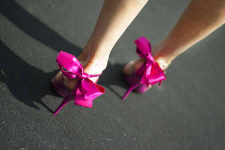 High heel pink female shoes with ribbon and bows