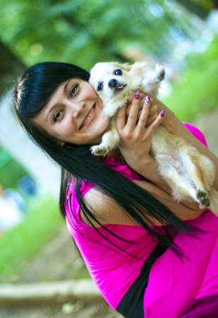 lapdog: Attractive young woman with cream color lapdog