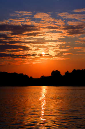 Gold sunset with clouds on the lake  Evening  The feeling of tranquillity
