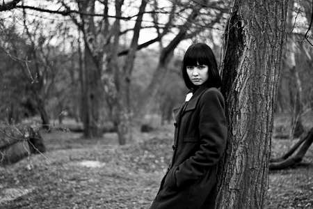 Portrait in black and white of beautiful, attractive girl in the forest photo