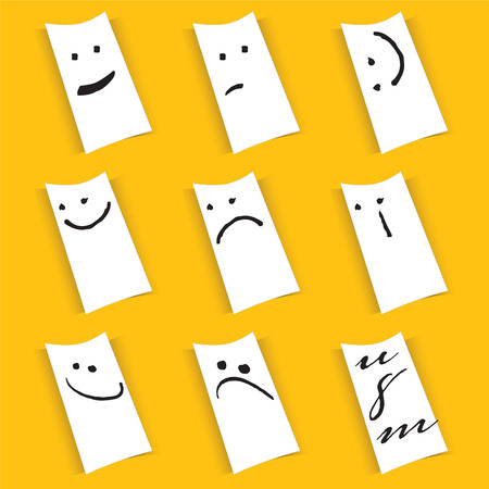 Funny paper notes with smileys isolated on yellow background.