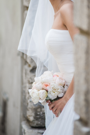 Beautiful bride with bouquet Stock Photo