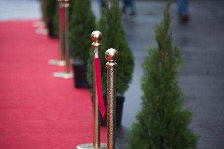 red carpet - is traditionally used to mark the route taken by heads of state on ceremonial and formal occasions Stock Photo