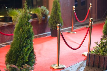 reserved: red carpet - is traditionally used to mark the route taken by heads of state on ceremonial and formal occasions Stock Photo