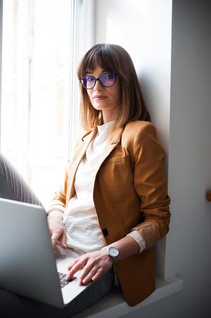 Beautiful young woman wearing casual glasses