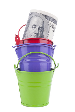 inwardly: Pile from buckets and by dollars inwardly. Stock Photo