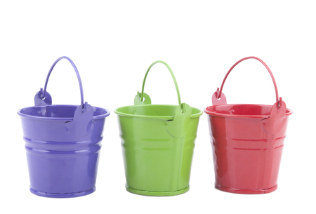 Three buckets of different colors, isolated on white . Фото со стока