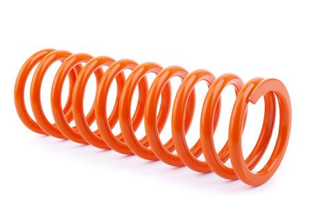 elasticidad: Resorte del metal rojo en un blanco. Foto de archivo