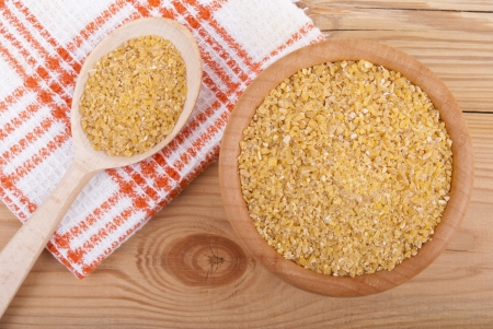 kuskus: Wheat cereal in a bowl on the table. Stock Photo