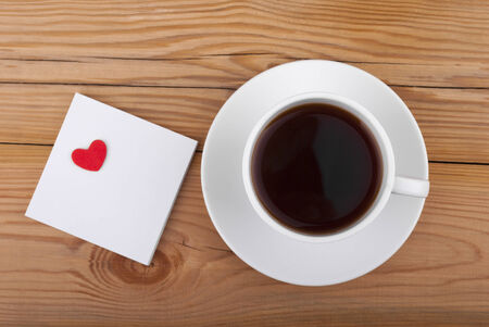 Cup of coffee and heart on wooden background Stock Photo - 26036498