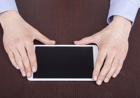 Businessman hands are touching on contemporary generic tablet pc. photo