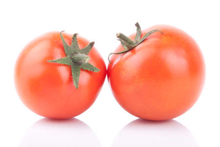 Two red tomatoes isolated on a white background. photo