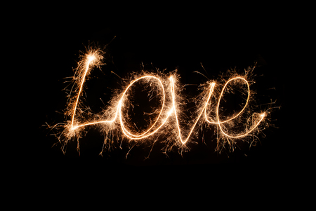 The inscription Love from sparklers Фото со стока