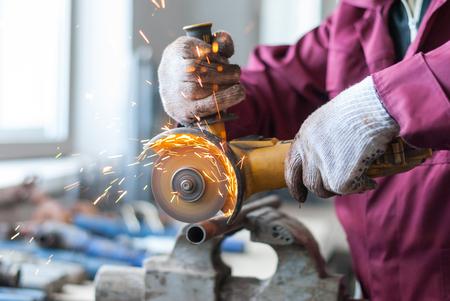 metal cutting: Man cut metal cutting wheel. Stock Photo