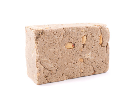 goody: Halva with nuts on a white background. Stock Photo