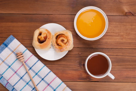 microelements: Tea with honey and cookies on the kitchen table. Stock Photo