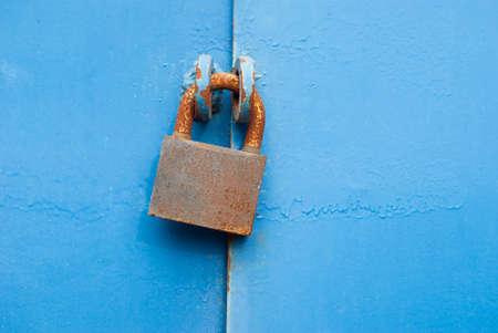 metal gate: Old padlock on metal gate.