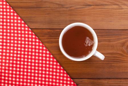 Tea table cloth on a wooden table. Stock Photo