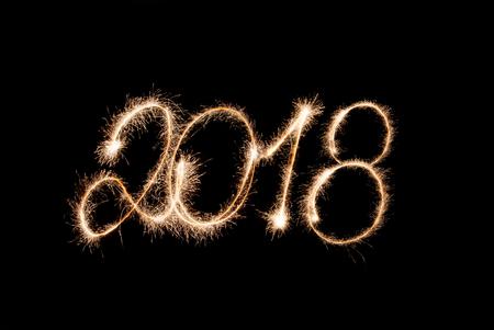 2018 - figures written by sparkler lights on a black background.