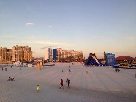 Sunset on the beach in Clearwater, Tampa. Walk through the warm sand on beautiful Clearwater Beach at sunset in a dreamy sunset in Tampa. Stock Photo