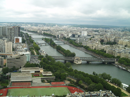 Paris from the Eiffel tower. Views of Paris and its romantic Seine river from the Eiffel tower.