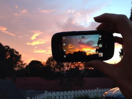 capturing: Capturing sunset with a Nokia smartphone Stock Photo